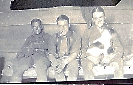 Myles Carrick, Jack Bagnall (with pipe) and Maitland Turner (MC) with dog. Taken in Locre 1916